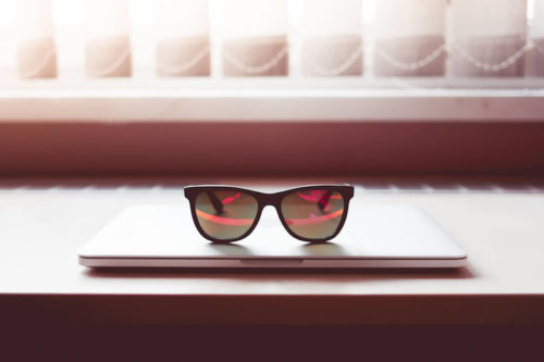 sleek-sunglasses-on-closed-macbook-laptop-picjumbo-com